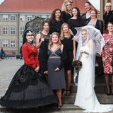group wedding photo with the bride under white lace umbrella