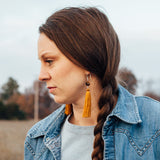 Girl wearing jeans jacket and Ochre Brown Long Dangle Tassel Earrings