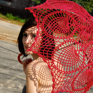 girl under red lace parasol