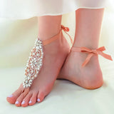 Back of the crystal barefoot sandals foot jewelry for a beach wedding