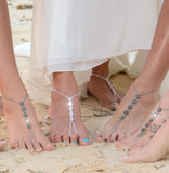 Beach wedding Bride and her Bridesmaids wearing gray Swarovski barefoot sandals