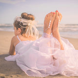 flower girl wearing swarovski barefoot sandals