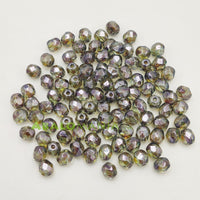 Facetada checa / 4mm / Color olivine hematite / Paquete de 100 unidades