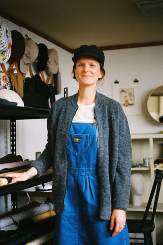 Emma in her Studio wearing hej hej Bombes and Blades knit