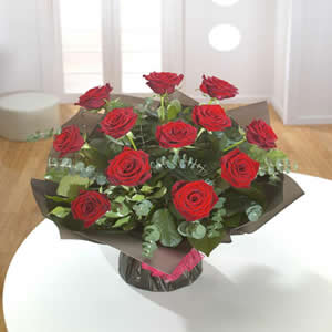 Amazing dozen roses hand tied bouquet