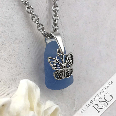 Deep Glowy Cornflower Blue Sea Glass Pendant with a Butterfly Charm