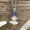 September Birthstone Crystal Clear Sea Glass Necklace with a Sapphire Blue Swarovski Crystal