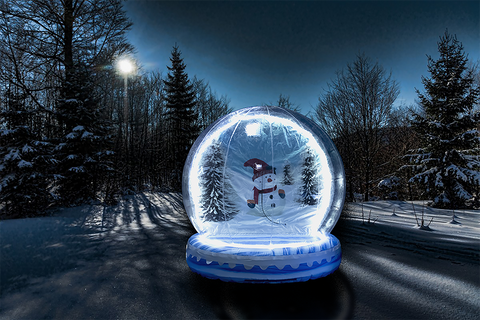 Inflatable snowglobe in a winter forest
