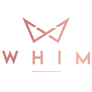 Whim Collection Logo in rose gold. Logo contains a W shaped crown with text that reads 'whim' with a line underneath.
