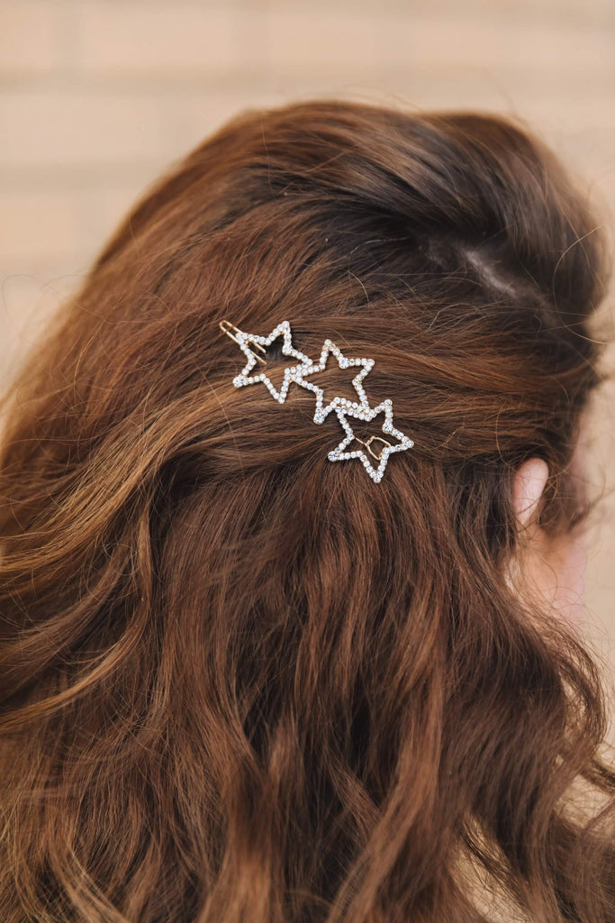 Whim Collections broadway star Hair Clip with three rhinestone stars shot on brunette model with hair pulled back behind ear.