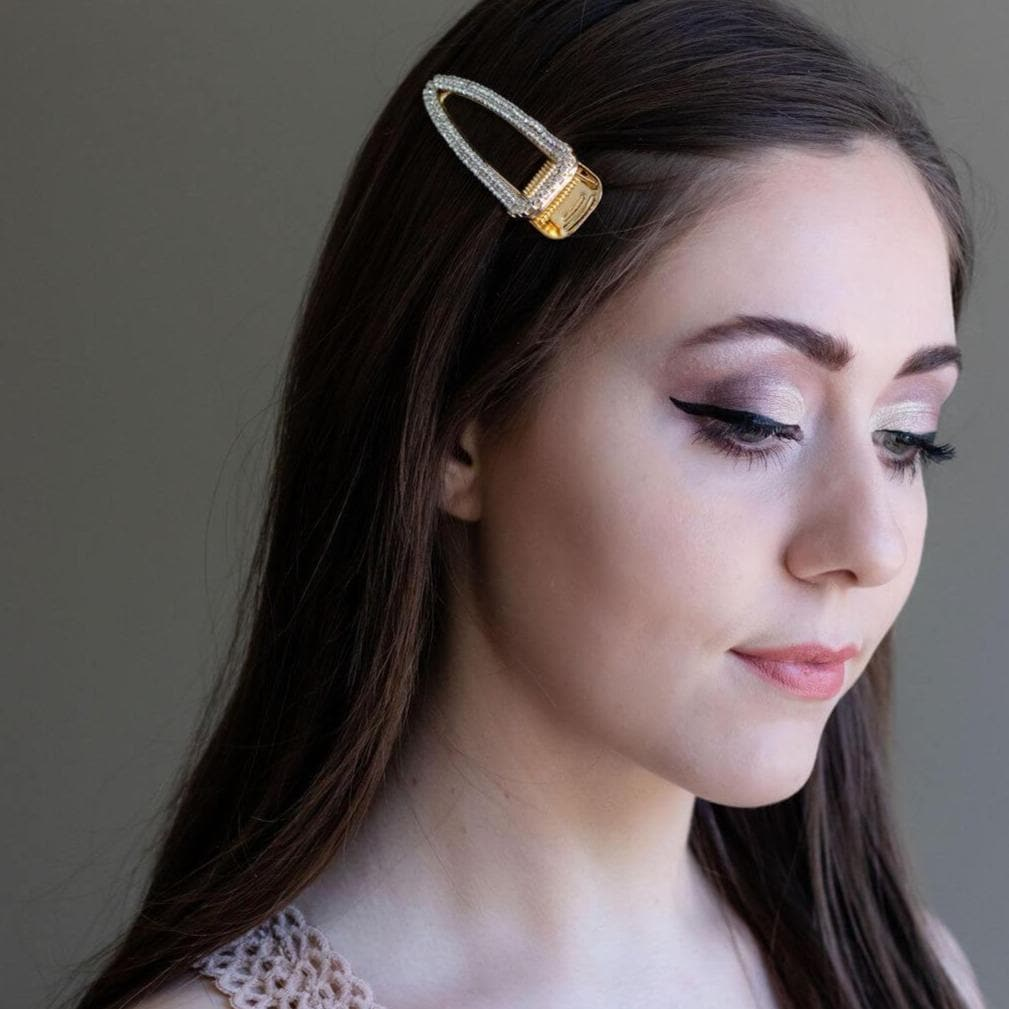 Arlington rhinestone adorned butterfly hair clip shot on brunette model.