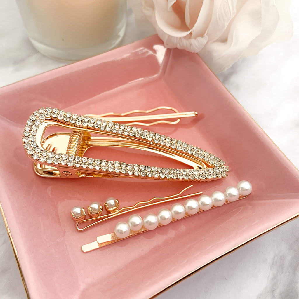 Gold Hair Accessories shoti n pink jewelry tray.  Styles shown are Arlingtin Hair Clip and Covington Pearl Hair Clips.