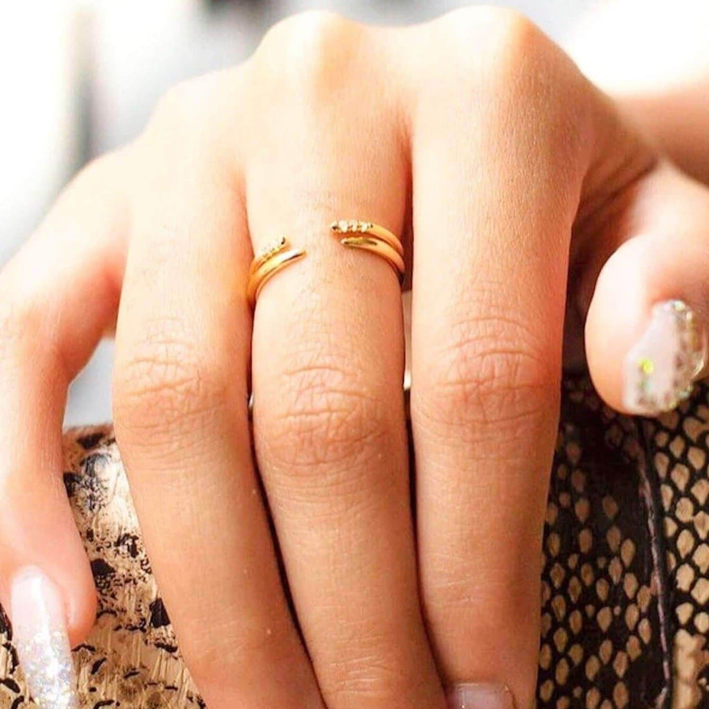 Austin Gold Open Claw Pave Ring featured with August Open Claw Ring in Gold on model. Model is resting her hand on a snakeskin purse.