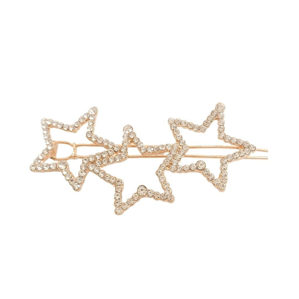 Hair Barrette shot on white background featuring a trio of rhinestone embellished stars on a glowing gold barrette