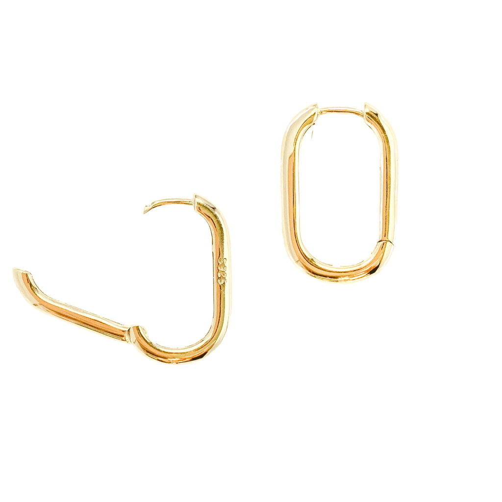 Gold flat oval hoop earrings shot on white background. Left earring is featured in open position displaying hinge closure and  S925 hallmark.