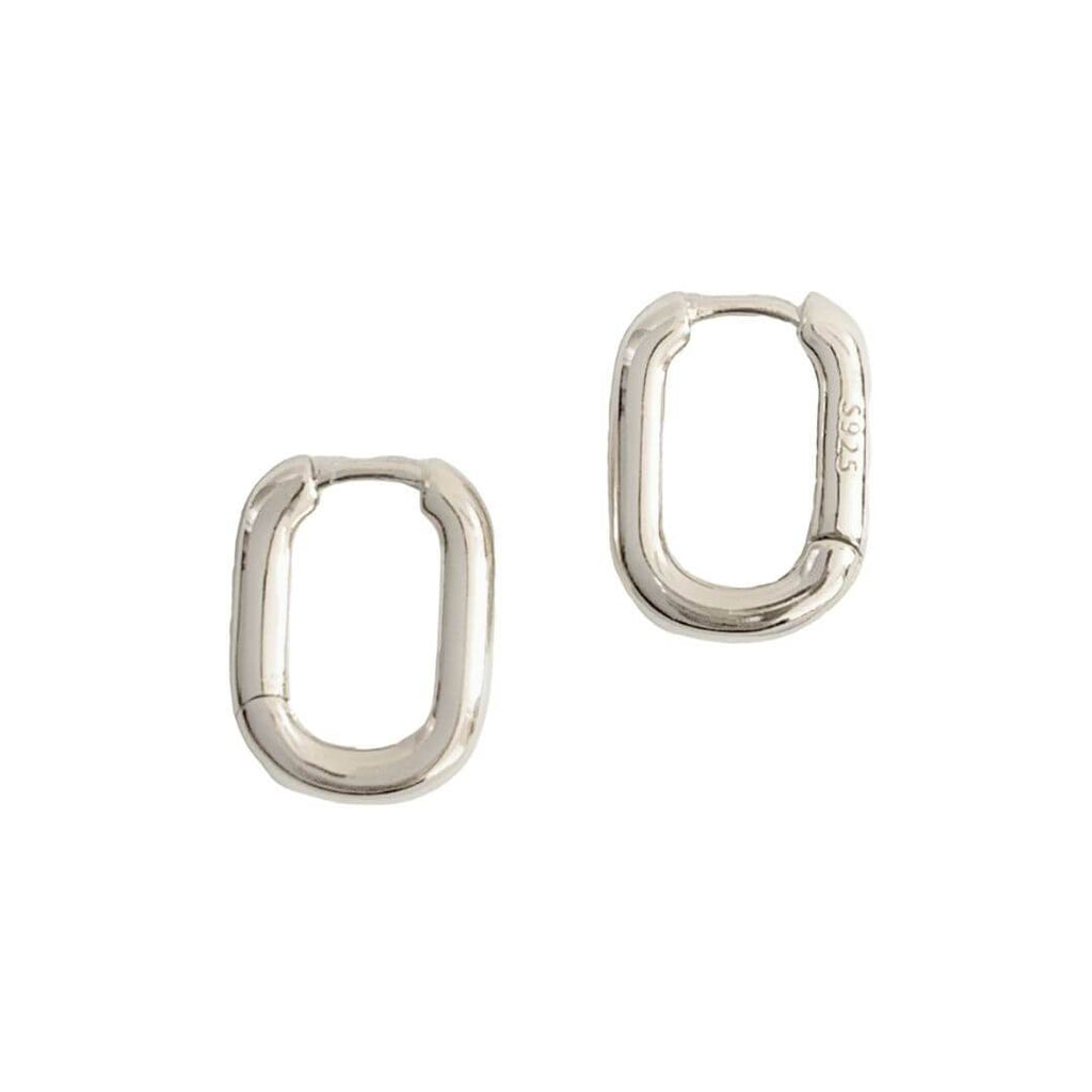 "Small oval shaped hoop earring shot on a white background. The earring is stamped wthi ""S925"" signaling the high quality sterling silver material."