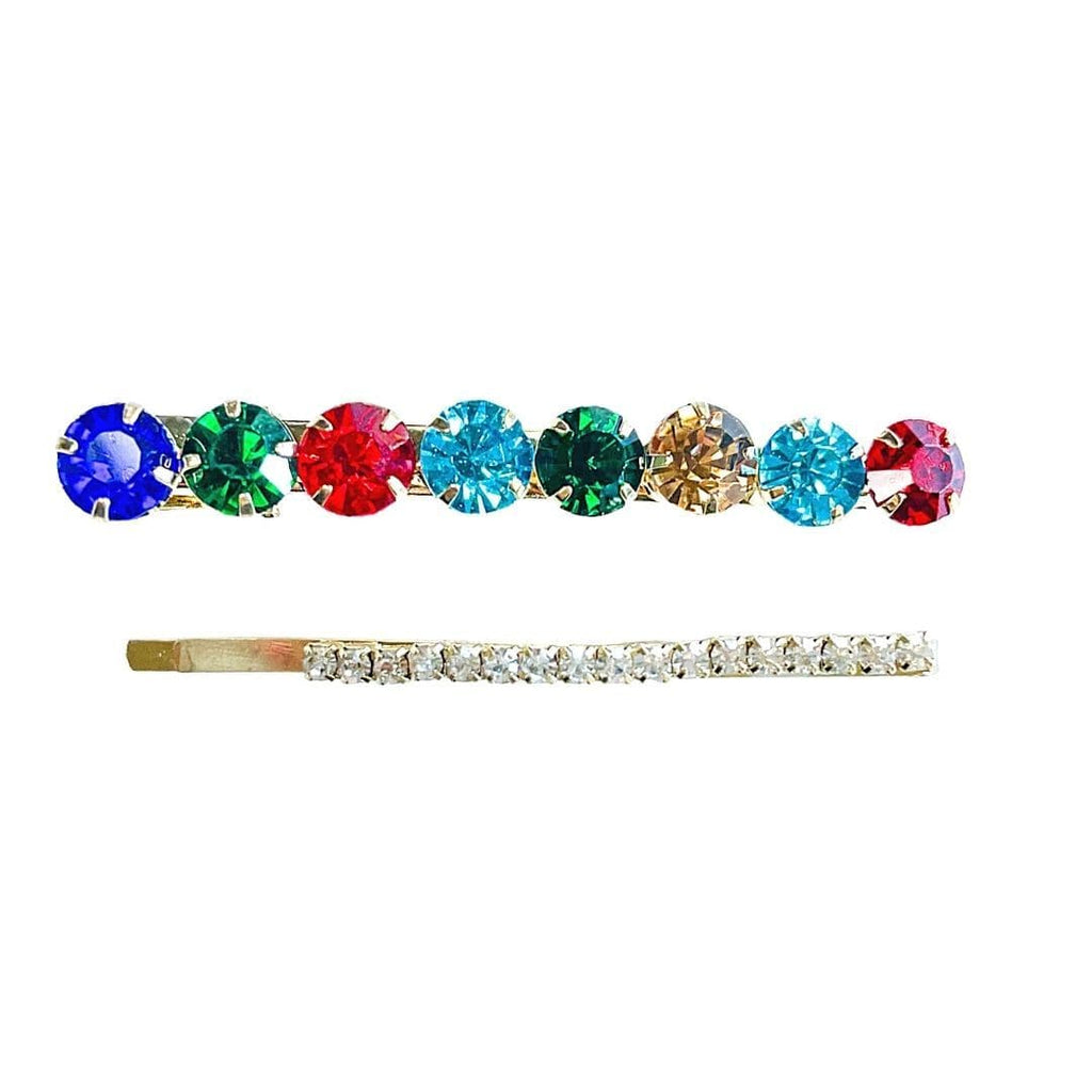 Kensington Jewel Toned gold hair clip set shot on a white backgound. This set features one jewel toned hair with 8 stones of varying colors and one crystal lined bobby pin.