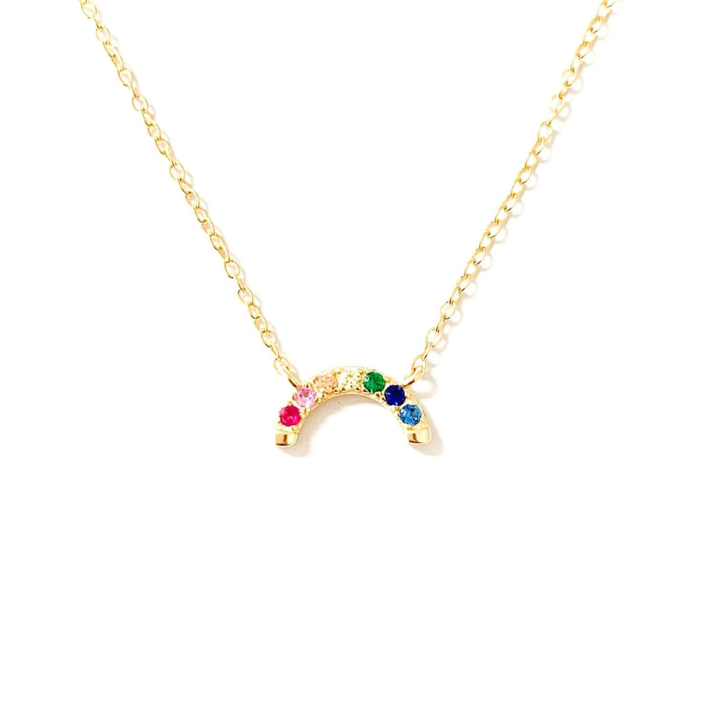 Oz Gold Mini Rainbow Choker shot on a white background. The small rainbow shaped pendant is adorned with one red, pink, orange, yellow, green, navy and blue stone.