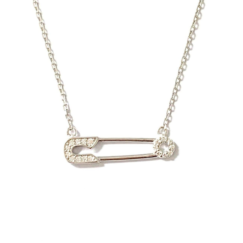 925 Sterling Silver Pave Safety Pin Necklace. This image shows the Silver Pave Safety Pin Connected by a silver chain on the top of each safety pin end. The necklace is shot on a white background. This necklace also comes in Gold.