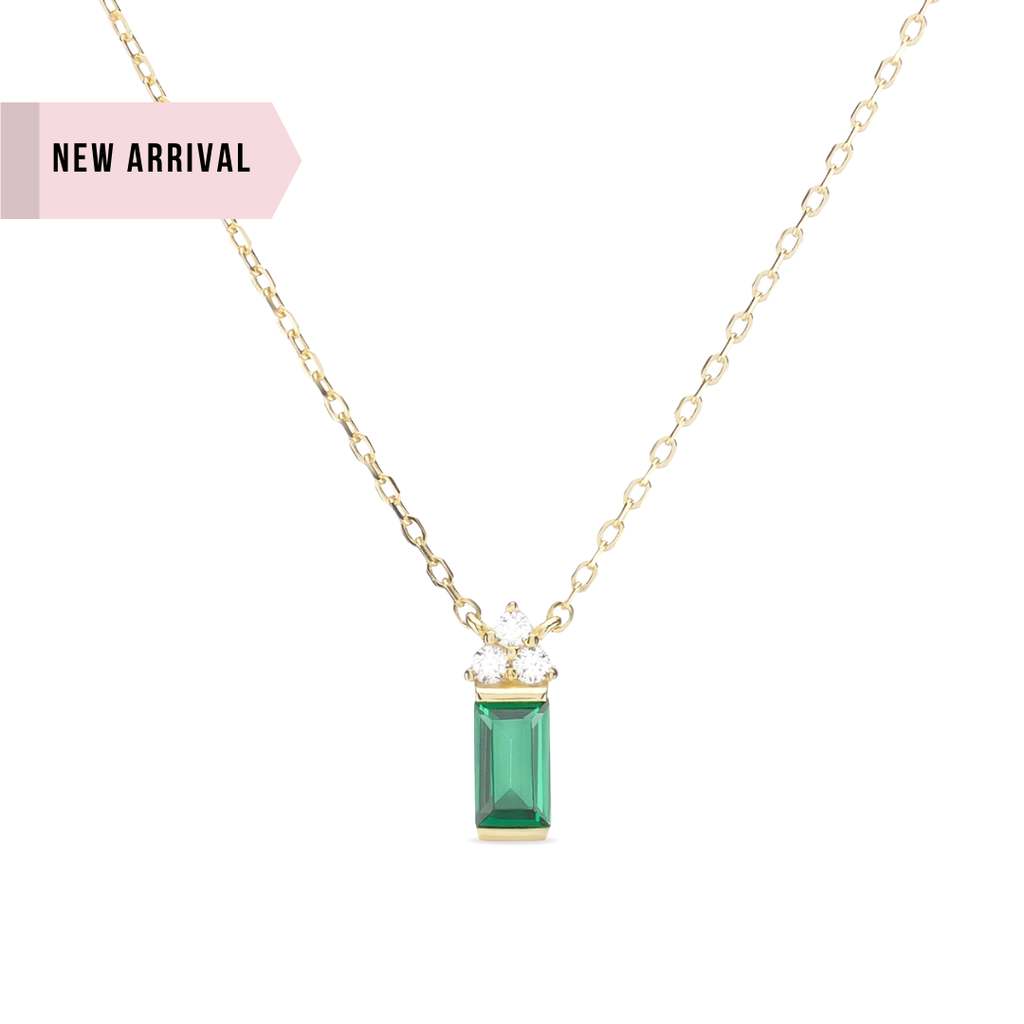 Elliott Emerald green dainty gold necklace shown on white background. In this image, you can really see how the 3 round zircons on top of the tall rectangle form a triangle with one zircon stacked centered on two below.