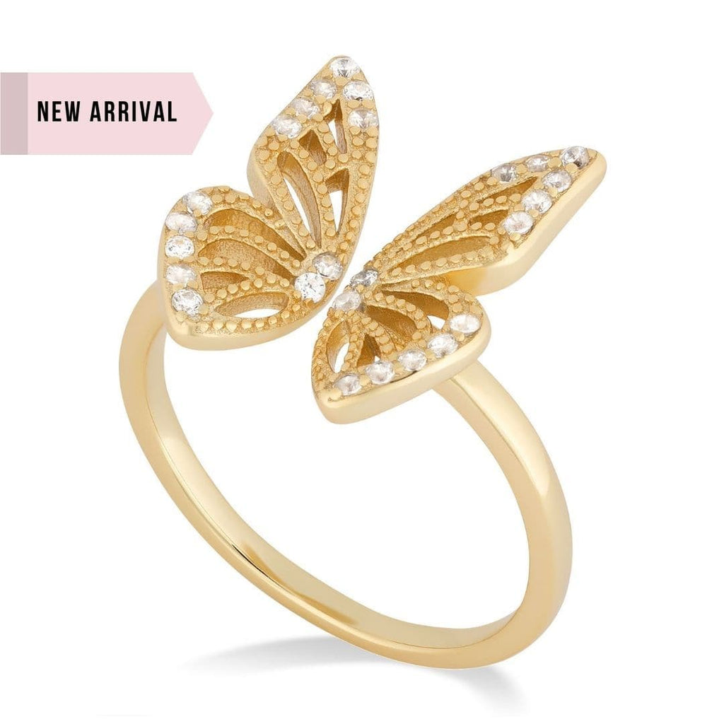 Cameron Gold Butterfly Ring Shot on white background. This ring features and open design with a small gap between the wings. The wings feature a cut out design and are adorned with tiny zircon on the center body and the outside of the wings.