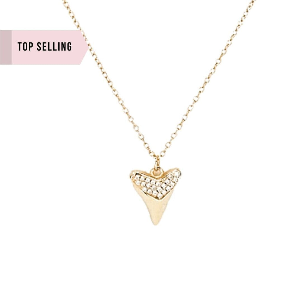 Whim Collections Mesa Shark Tooth Pendant Necklace featured on white background. This lightweight gold vermeil necklace is adorned at the top with sparkling cubic zircon
