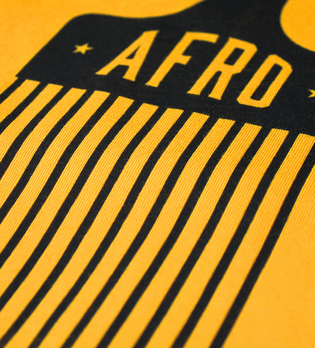 Close up photo of men's Afro Pick shirt
