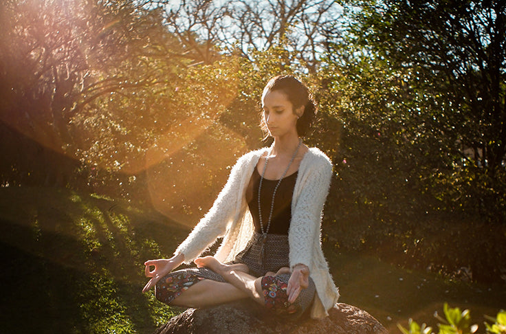 woman meditating ned cbd products