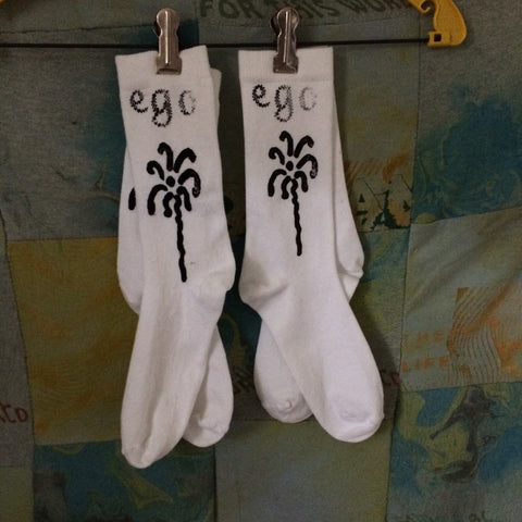 white Ego disintegration socks