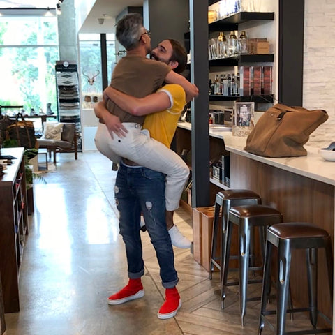 Tan France jumped into JVN's arms as soon he walked into ULAH