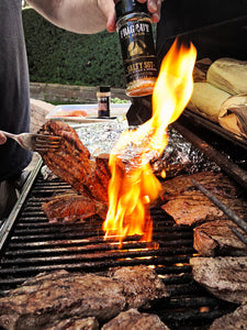 Salty SGT steaks on grill with flame