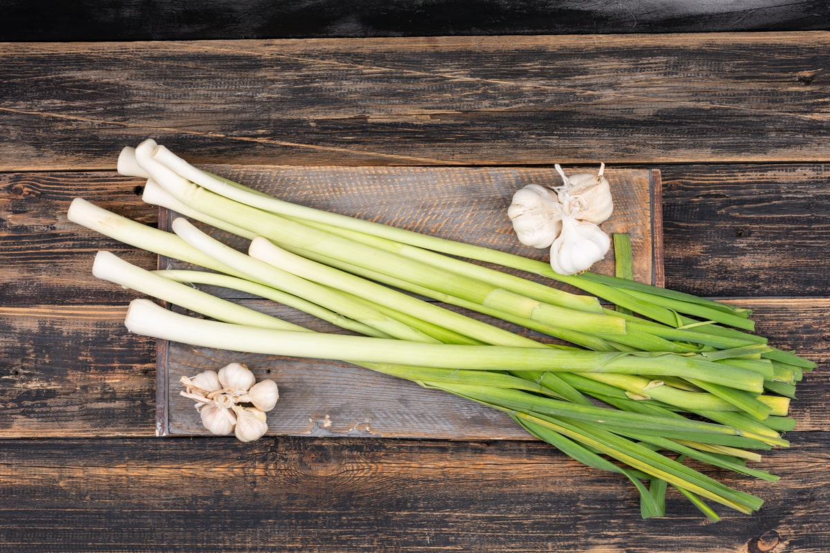 Chives and garlic on the top of chopping board