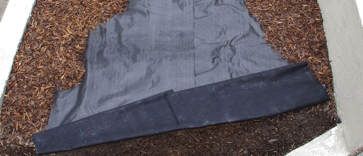 Ecogardener Landscape Fabric With Wood Chippings on Top
