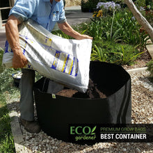 Man putting soil in ecogardener grow bags