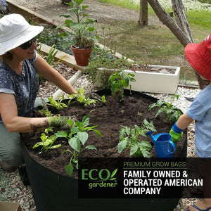 Mother and daughter planting plants in ecogardener grow bags