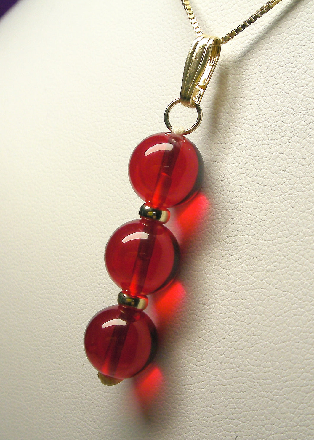 Red Andara Crystal with Gold Pendant (3 x 10mm)