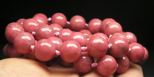 Rhodonite EO 10+mm 25.5inch - Tools4transformation