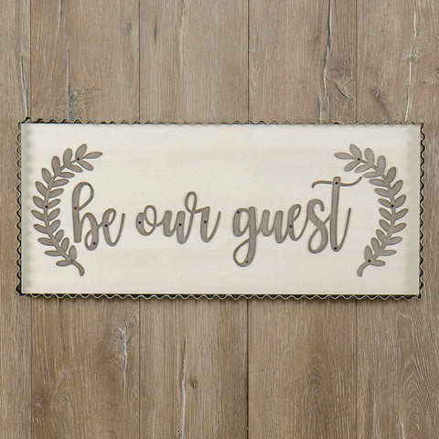 white wood sign with be our guest in galvanized metal from one cottage way