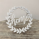 Home, Gather, Love , Hello white metal shelf sitter sign with laurel wreath detail from One Cottage Way Coastal Farmhouse Decor