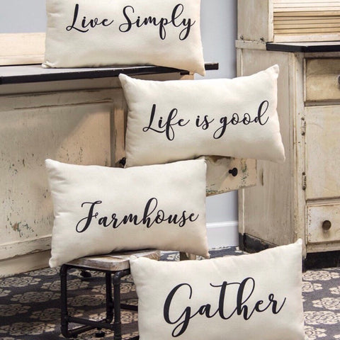 canvas throw pillows with farmhouse, live simply, gather, and life is good in black magnolia font