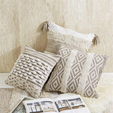 Beige, tan and cream woven throw pillows in tassel, knotted, and diamond pattern from One Cottage Way