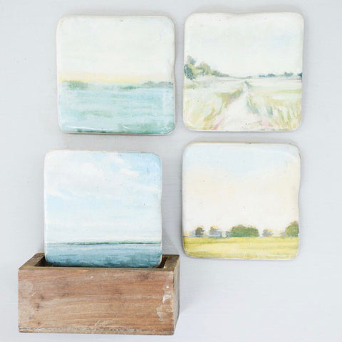 Coaster set of 4 with watercolor landscapes on each and a wood holder from One Cottage Way