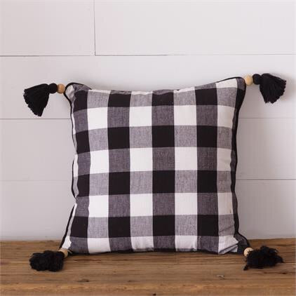 Black and White Buffalo Checked Throw Pillow with wood bead and tassel details on corners 16 by 16