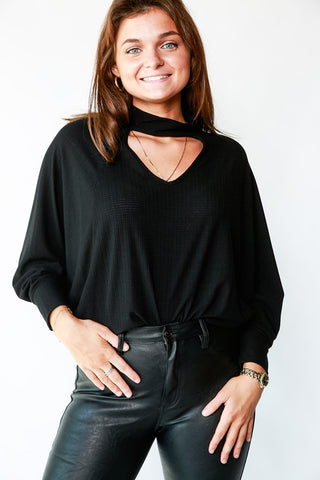 CUT OUT NECK TOP WITH BAT WING SLEEVES
