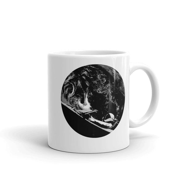 Unisex Starman mug is Inspired by the SpaceX Falcon Heavy Starman in a Tesla launched by Elon Musk. This coffee mug has a black and white image of the mannequin driving a Tesla Roadster in space in front of earth.