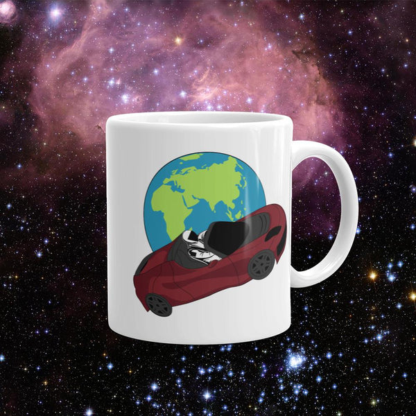 Starman coffee mug Inspired by the SpaceX Falcon Heavy Starman in a Tesla launched by Elon Musk. This mug has the astronaut mannequin driving a Tesla Roadster in space in front of earth.