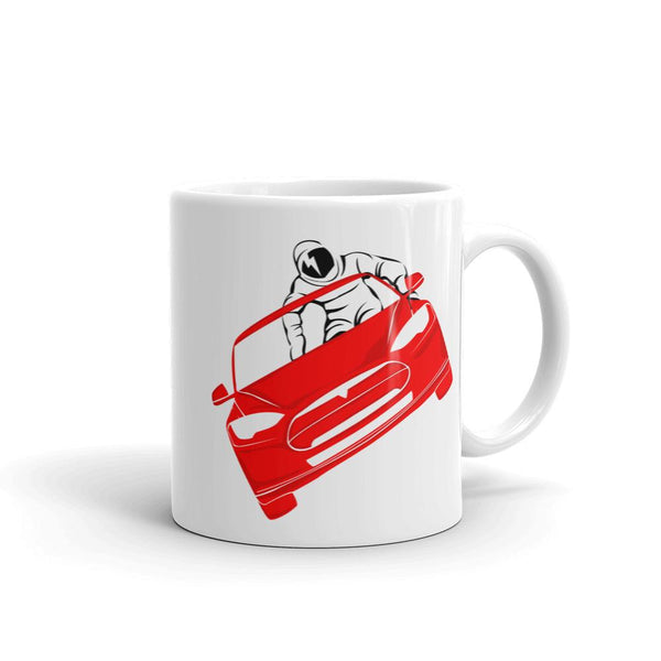 Starman mug inspired by the SpaceX Falcon Heavy Starman in a Tesla launched by Elon Musk. This coffee mug has the astronaut mannequin driving a Tesla Roadster in space with a David Bowie tattoo on his face.