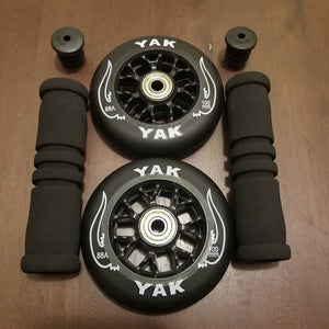 2x 100mm black skate or scooter wheels with handle bar grips