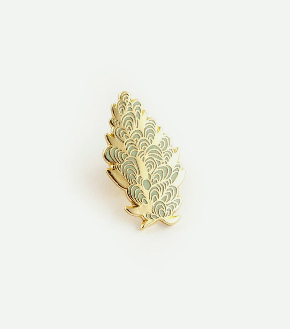 Cannabis bud enamel pin in gold and green.