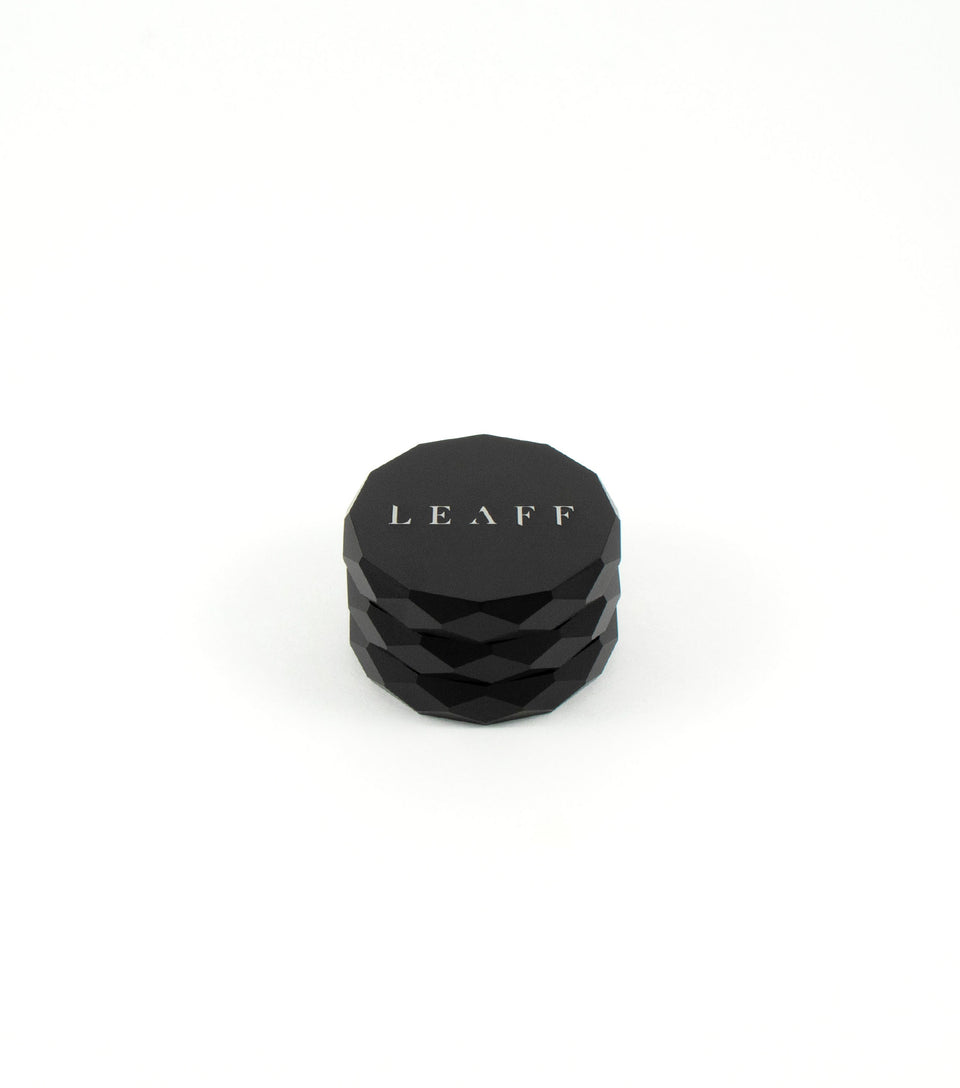 Modern designer weed accessories black grinder.